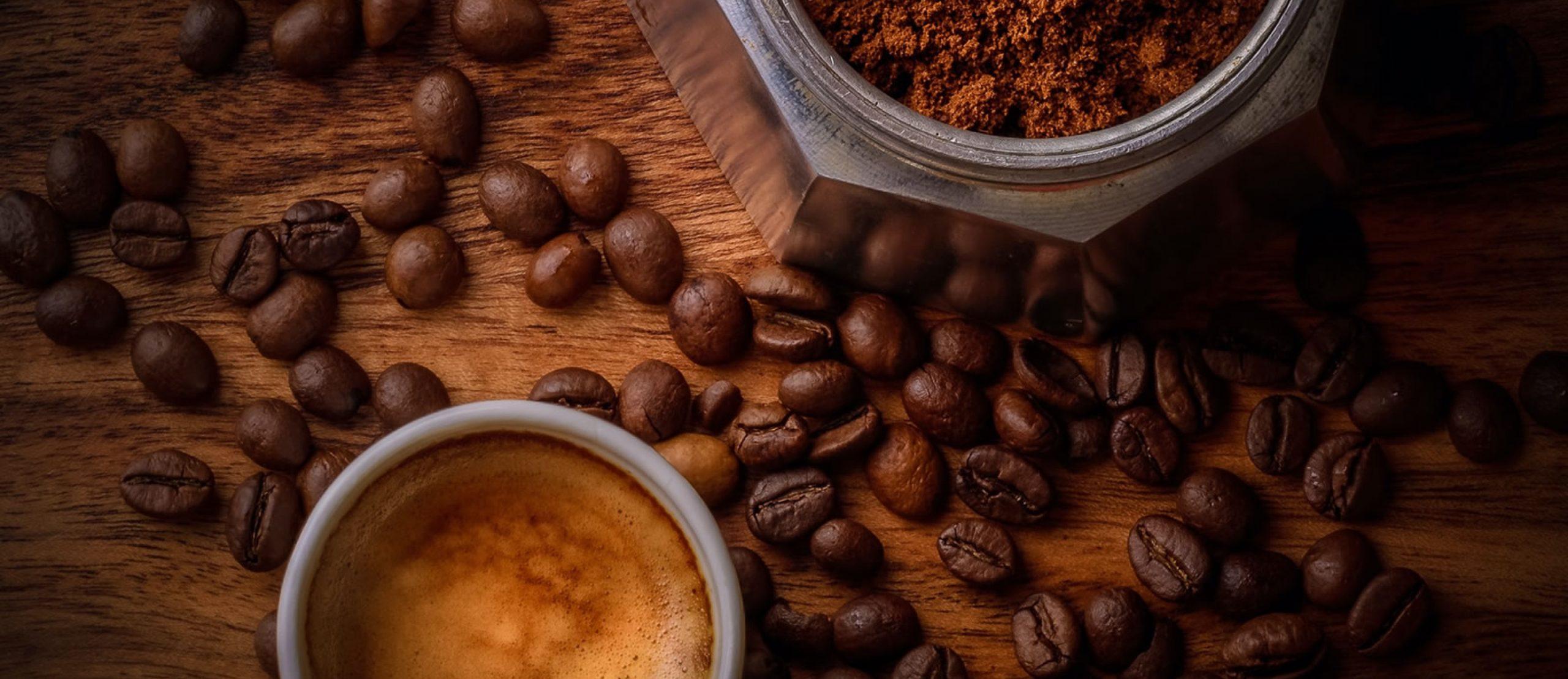 Caffia coffee beans with a mug on a tabletop
