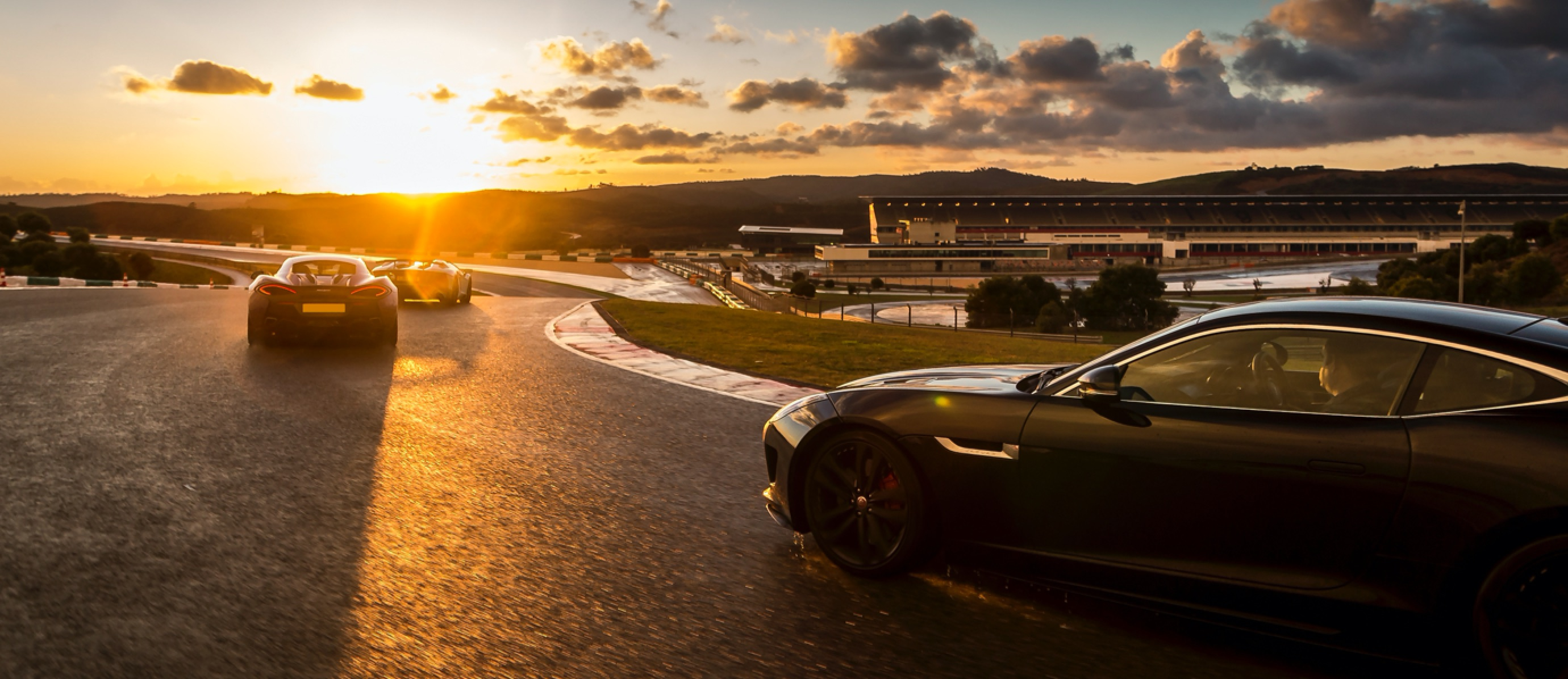 Gorgious sunset shot of supercars on a road