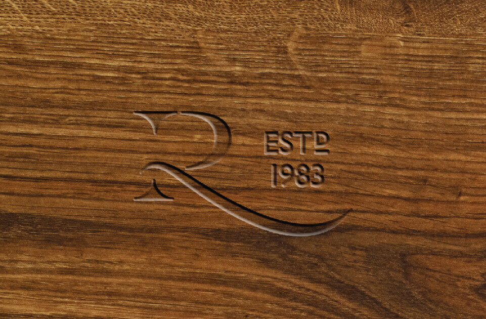 Revival Beds logo etched into wood