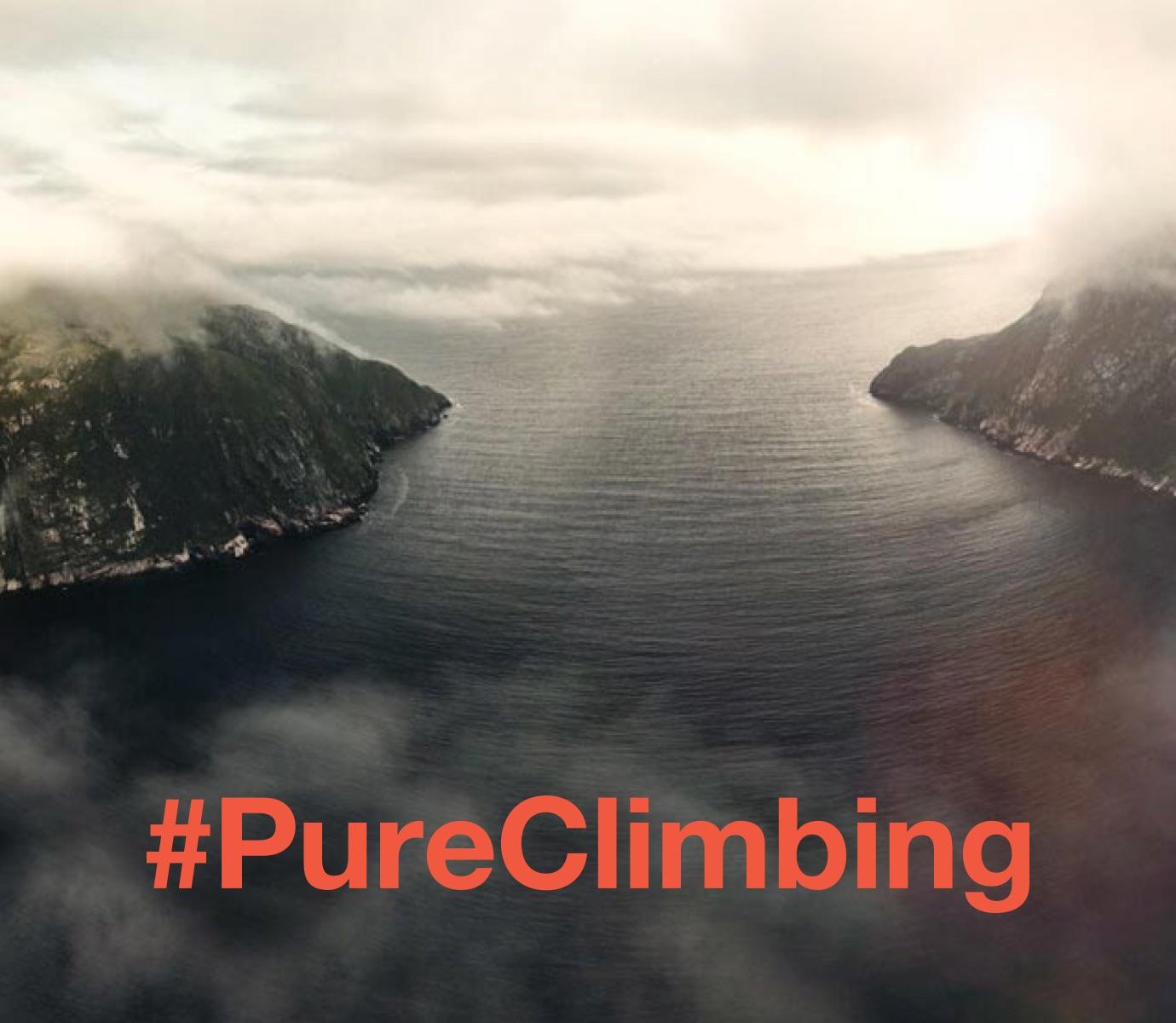 #PureClimbing hashtag overlaying a beautiful landscape