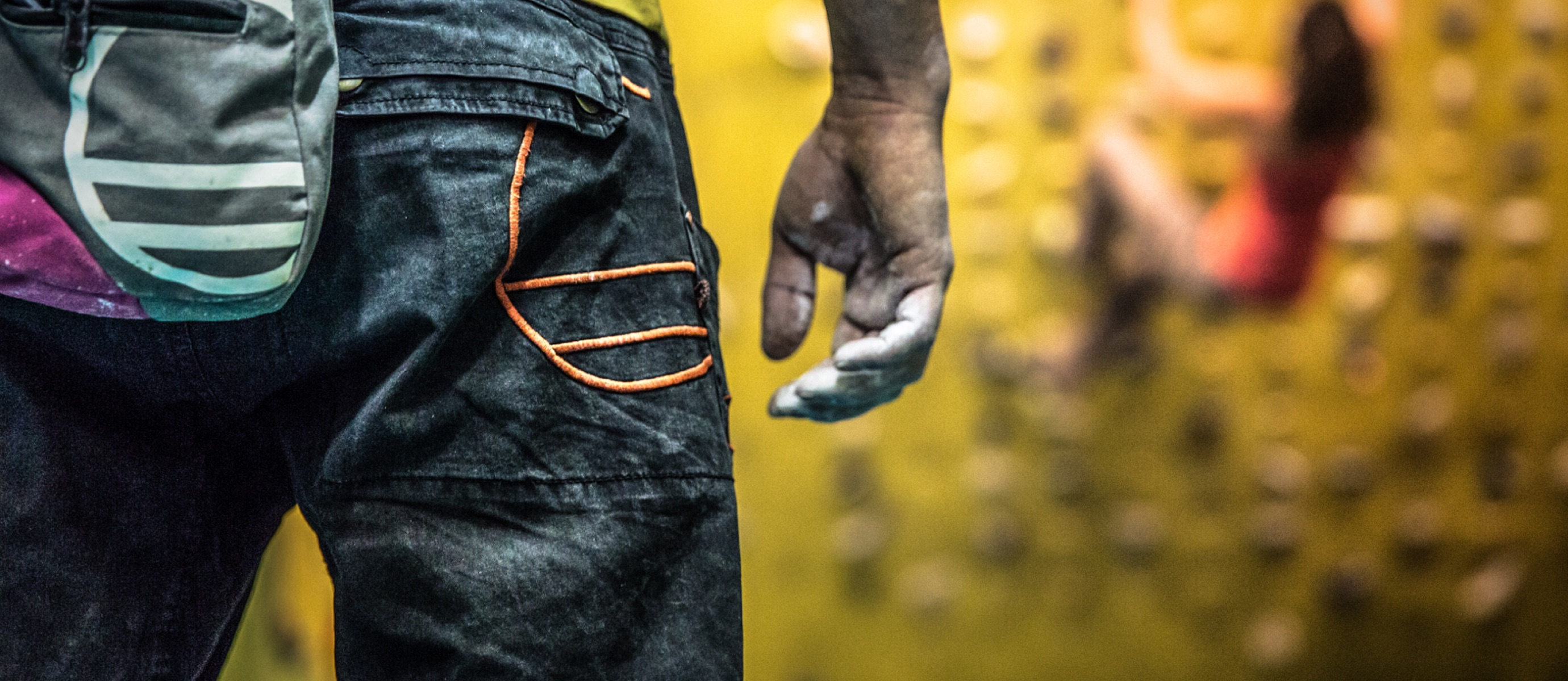Climber with chalk-covered hands