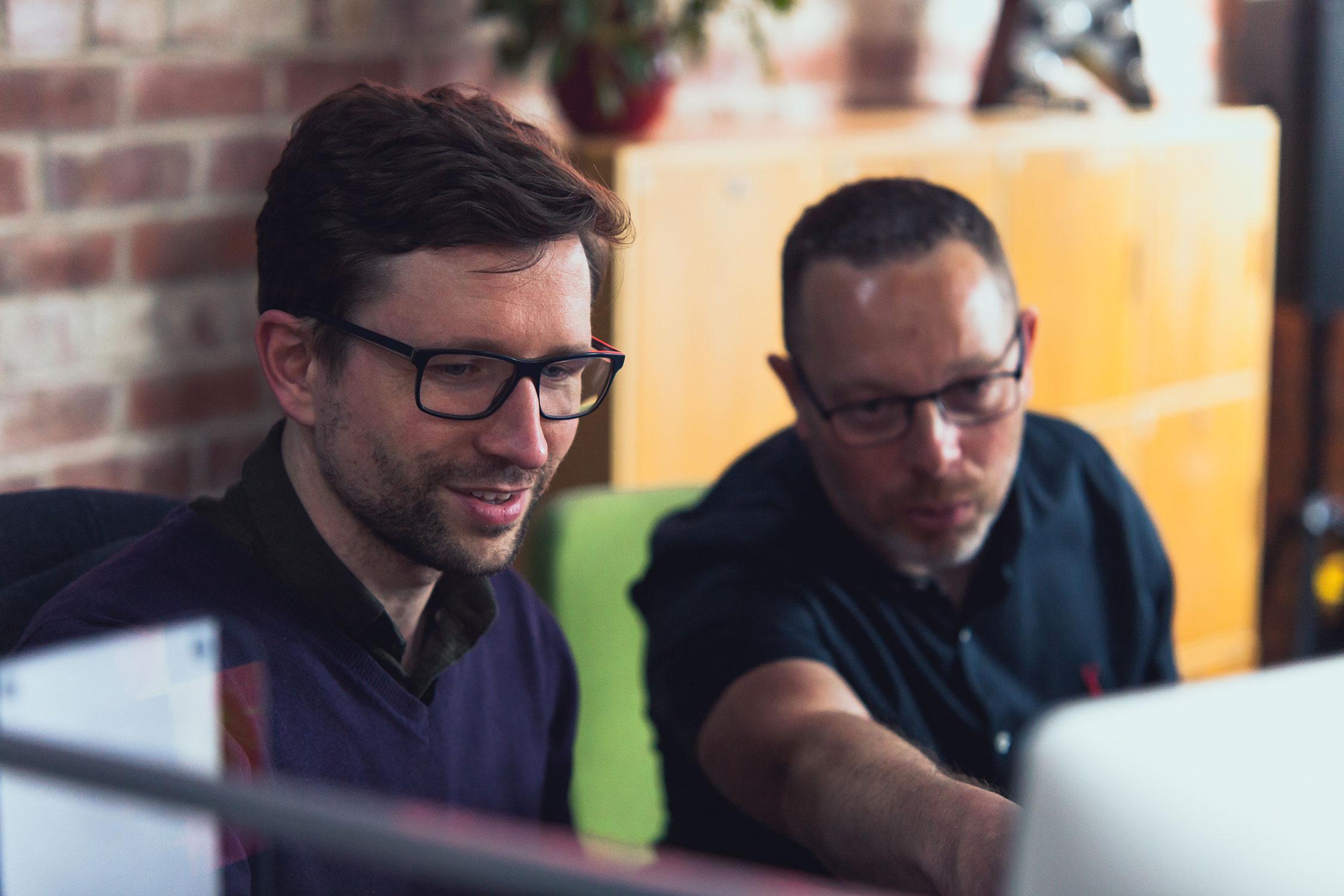 Matt Isherwood & Richard Calise discussing something on the Vivid studio Macs