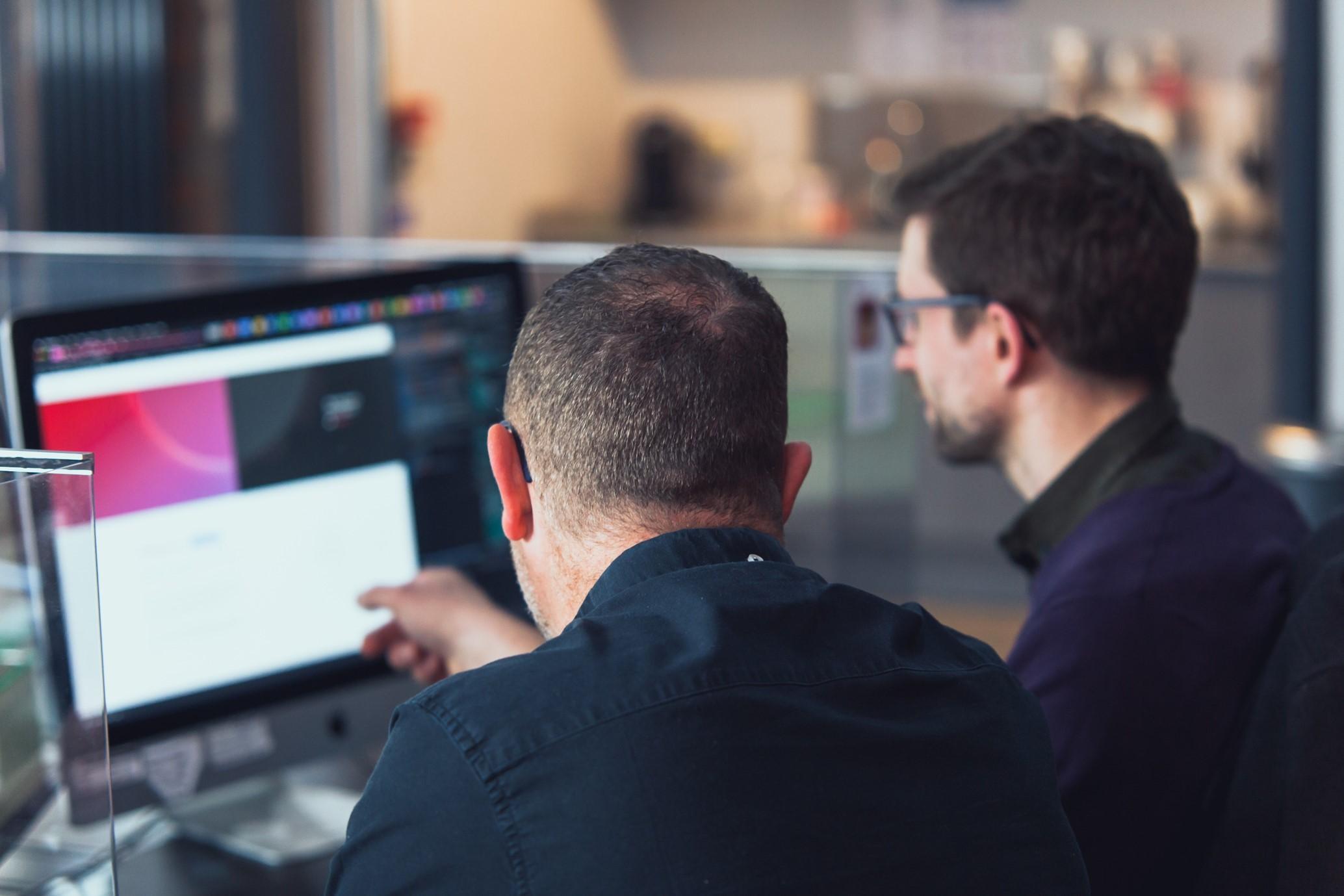 Matt Isherwood & Richard Calise discussing a digital project
